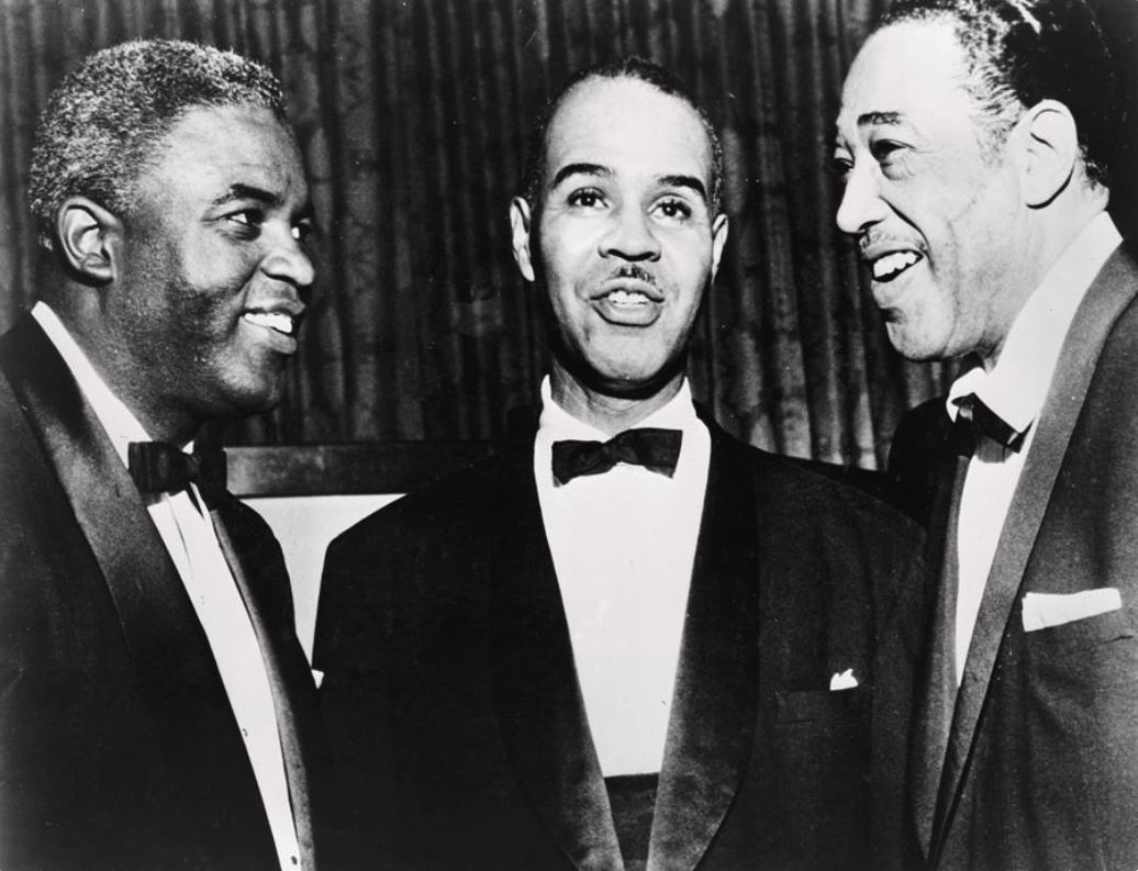 baseball_player_jackie_robinson_left_naacp_president_roy_wilkins_center_and_duke_ellington_right_talking_during_a_spingarn_medal_awards_ceremony.jpg