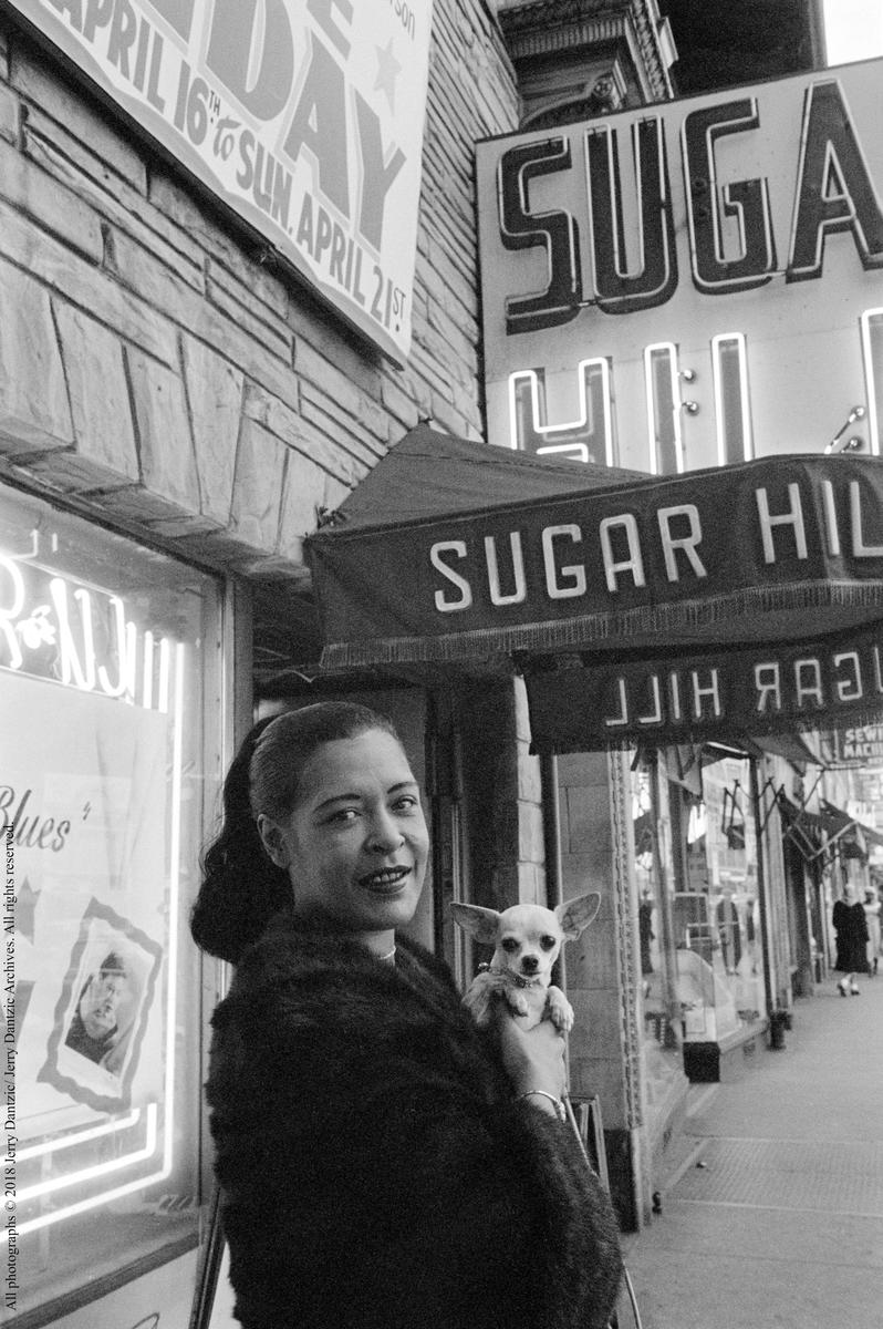 billie_holiday_holding_her_pet_chihuahua_pepi_in_front_of_sugar_hill_newark_new_jersey_april_18_1957.jpg